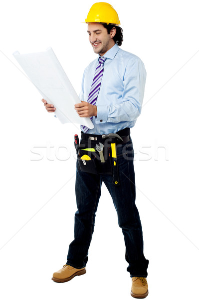 Construction worker reviewing blueprint Stock photo © stockyimages