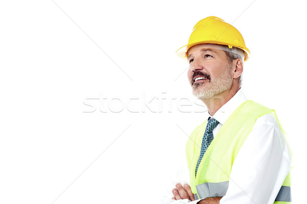 Confident architect with jacket and hard hat Stock photo © stockyimages