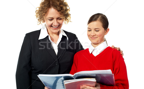 Teacher helping teen student one on one Stock photo © stockyimages