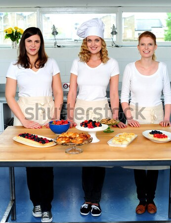 Professional chefs in commercial kitchen Stock photo © stockyimages