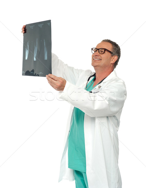 Experienced surgeon looking at x-ray report Stock photo © stockyimages