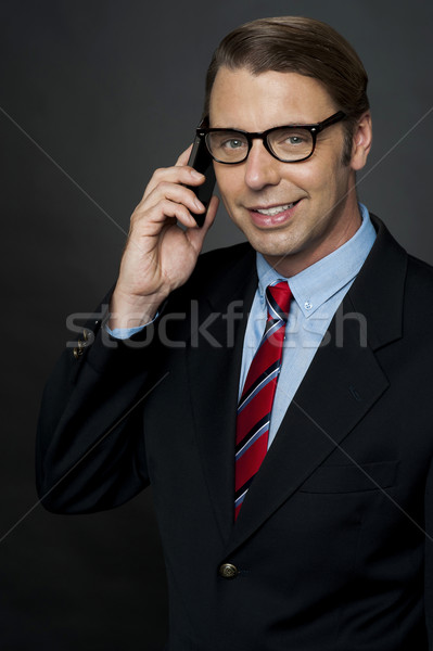 Business manager communicating via cellphone Stock photo © stockyimages