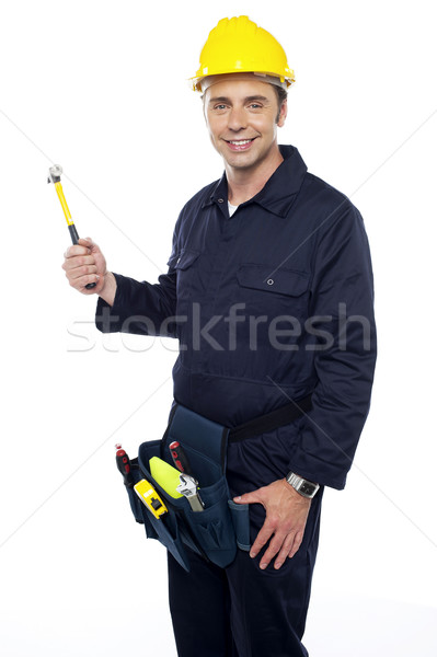 Repairman holding out hammer from his tool kit Stock photo © stockyimages