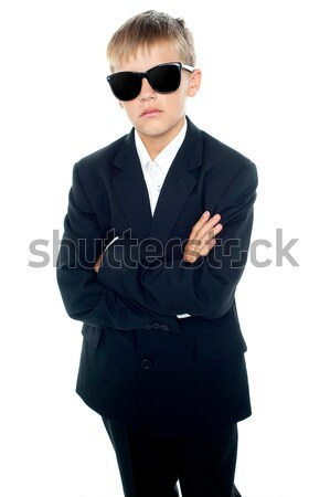 Snapshot of young kid wearing suit and sunglasses Stock photo © stockyimages