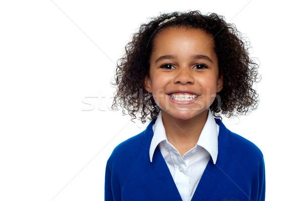Profil lövés hideg iskolás lány fogak kamera Stock fotó © stockyimages