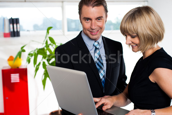 Secretary showing power point presentation to the boss Stock photo © stockyimages