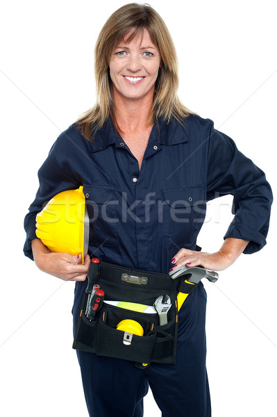 Self assured female architect holding hard hat Stock photo © stockyimages