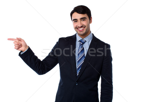 Smart businessman pointing at something Stock photo © stockyimages