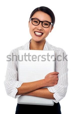 Female secretary holding laptop tightly Stock photo © stockyimages