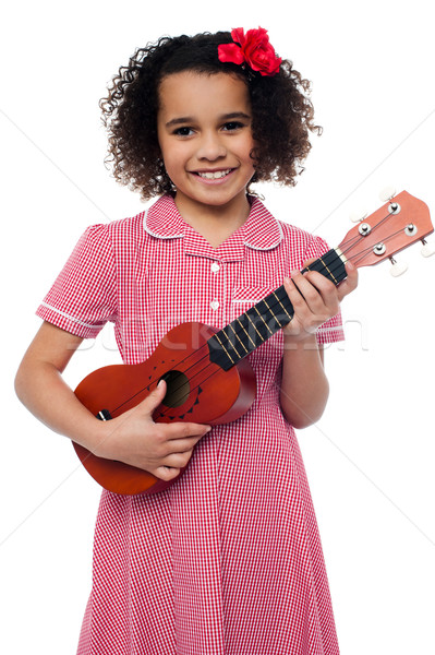 A little girl with a toy guitar Stock photo © stockyimages