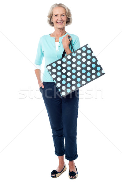 Charming senior lady with shopping bag Stock photo © stockyimages