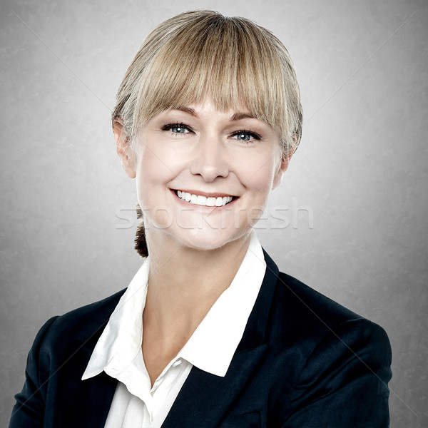 Smiling middle aged businesswoman Stock photo © stockyimages