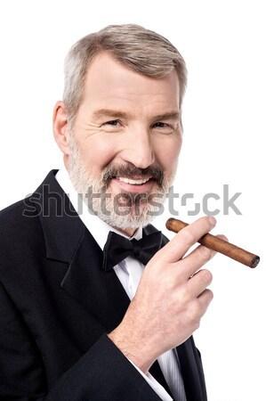 Meu ruim hábito senior empresário posando Foto stock © stockyimages