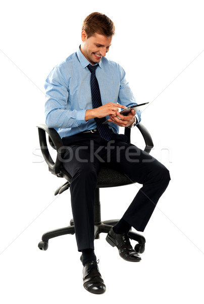 Full length shot of seated entrepreneur Stock photo © stockyimages