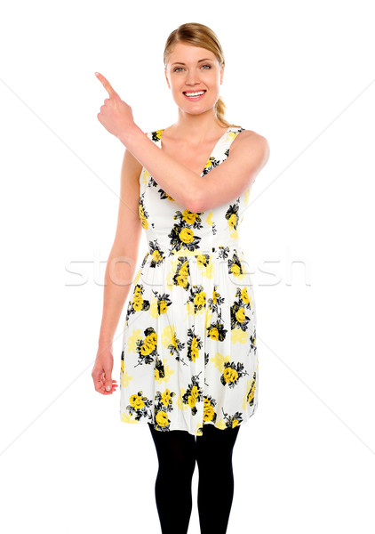 Pretty woman pointing upwards Stock photo © stockyimages