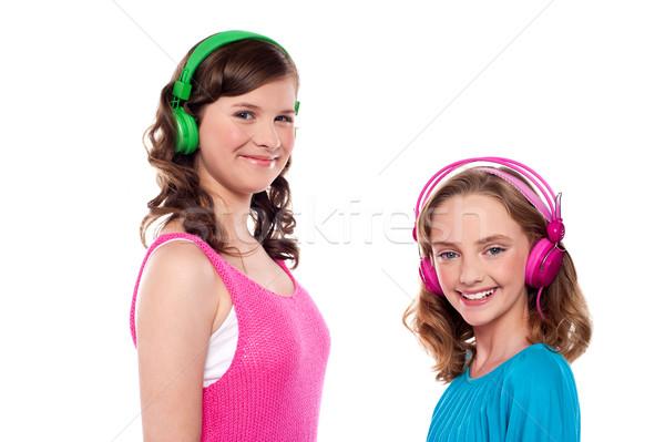 Holunder Schwestern Musik hören Kopfhörer weiß Mode Stock foto © stockyimages
