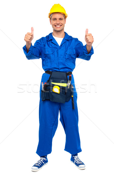 Successful young worker gesturing double thumbs up Stock photo © stockyimages