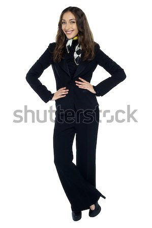 Pretty stewardess striking a stylish pose Stock photo © stockyimages