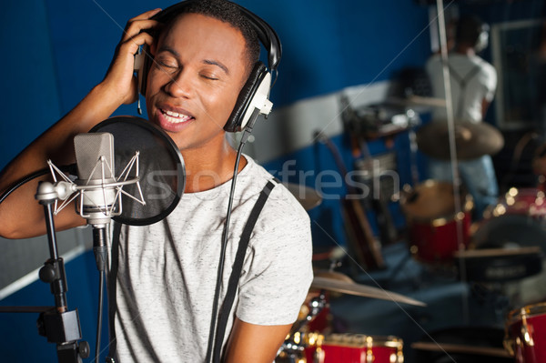 Singer recording a track in studio Stock photo © stockyimages