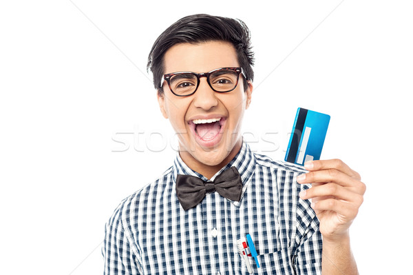 Laughing guy holding credit card Stock photo © stockyimages