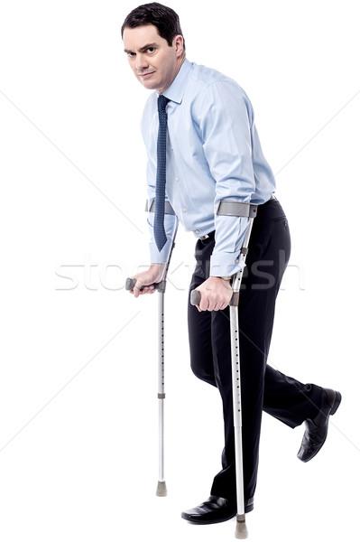 松葉杖 ヘルプ 私に 徒歩 ビジネスマン 白 ストックフォト © stockyimages