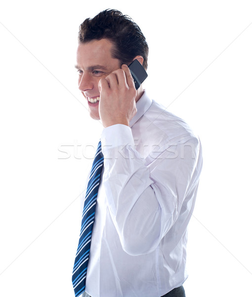 Stock photo: Side view of manager attending phone call