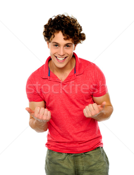 Excited young fellow Stock photo © stockyimages