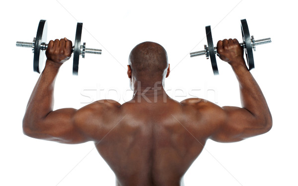 Rear view of a young male bodybuilder Stock photo © stockyimages