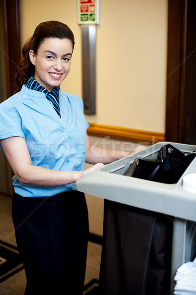 Female attendant posing with cart Stock photo © stockyimages