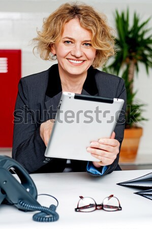 Secretary jotting down notes and instructions Stock photo © stockyimages