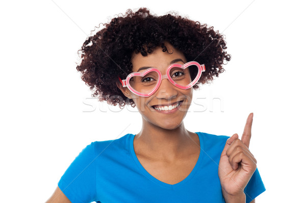 Pretty woman wearing funny heart shaped frame Stock photo © stockyimages
