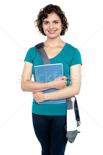 Főiskolai hallgató elegáns csúzli táska notebook trendi Stock fotó © stockyimages