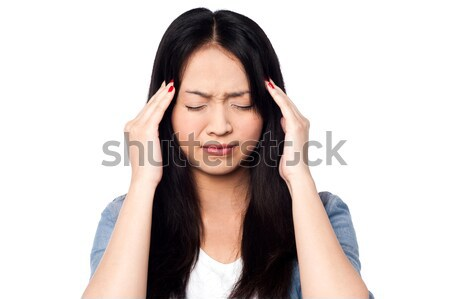 Young girl having headache Stock photo © stockyimages