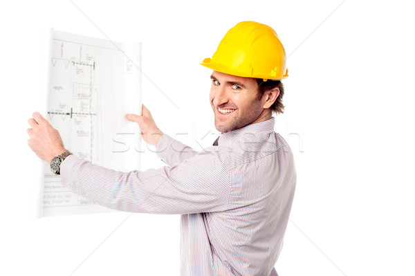 Smiling construction engineer reviewing blueprint Stock photo © stockyimages