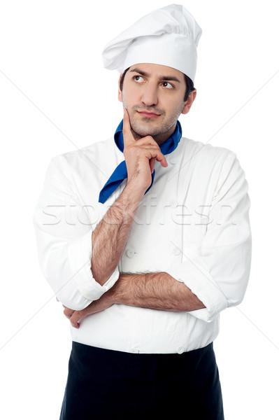 Hábil chef pensando algo jovem masculino Foto stock © stockyimages