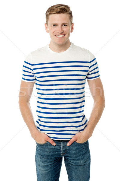 Stylish young guy posing casually Stock photo © stockyimages