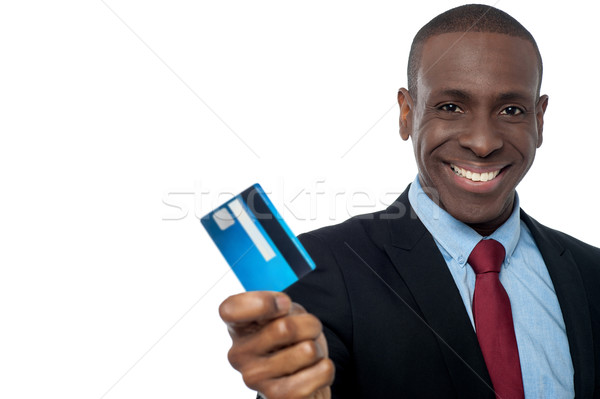 Cheerful businessman holding credit card Stock photo © stockyimages