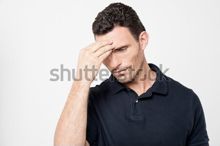 Worried man trying to remember something Stock photo © stockyimages