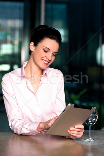 Woman selecting menu on digital tablet Stock photo © stockyimages