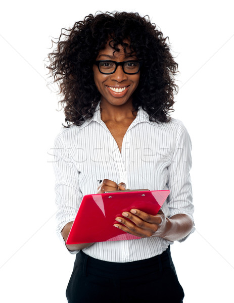 Beautiful business professional making notes Stock photo © stockyimages