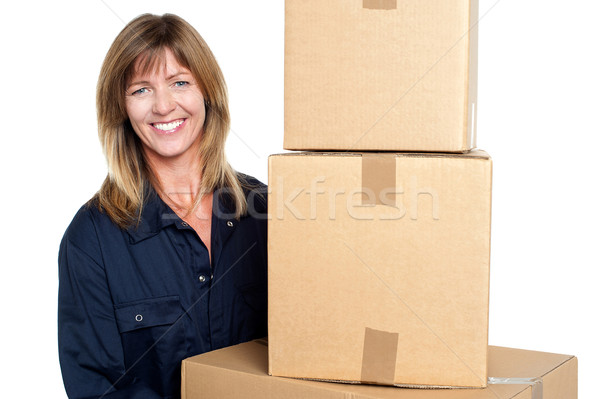 Cheerful delivery woman carrying sealed cartons Stock photo © stockyimages