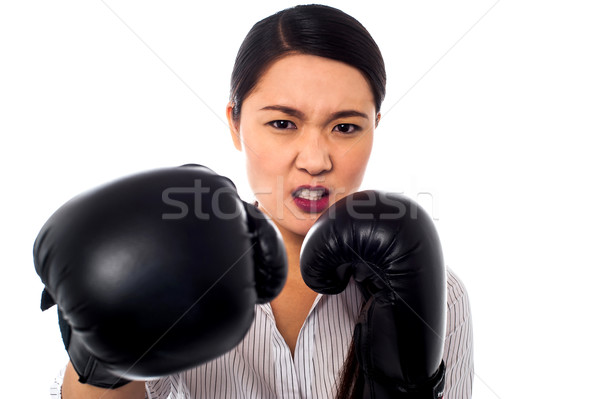 Female boxer with angry look on her face Stock photo © stockyimages
