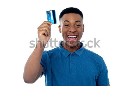 Woman displaying her cash card Stock photo © stockyimages