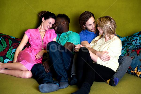 группа четыре друзей счастливым молодые Сток-фото © stockyimages