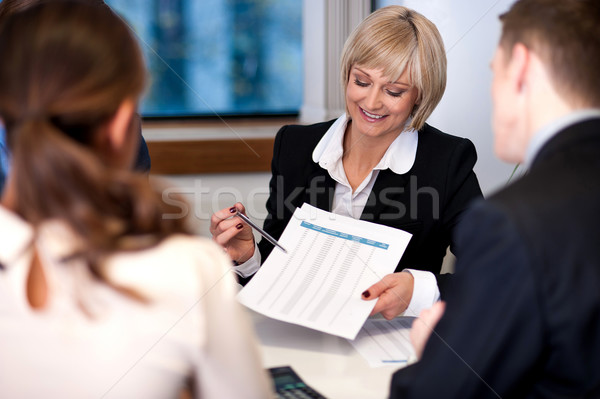 Company discussion going on in a meeting hall Stock photo © stockyimages