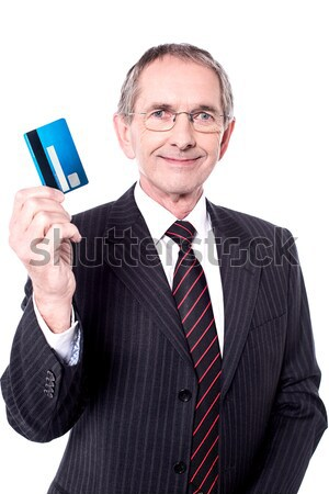 Smiling businessman holding credit card Stock photo © stockyimages