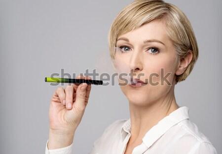 Nő kép modern dohányzás technológia füst Stock fotó © stockyimages