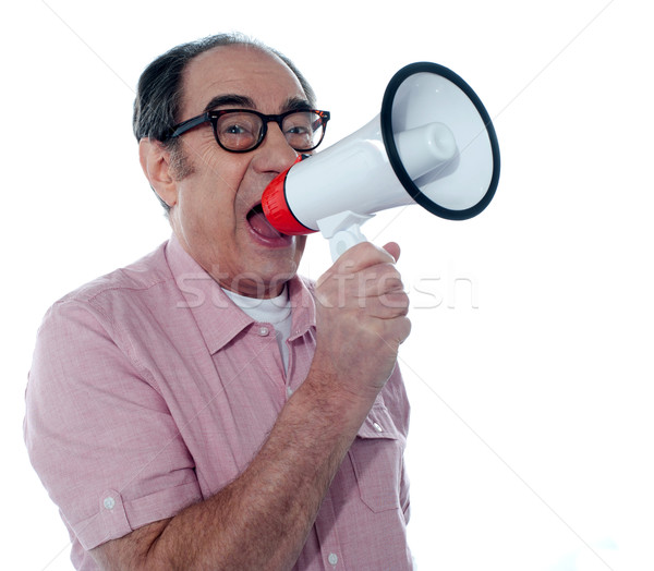 Senior casual male with megaphone Stock photo © stockyimages