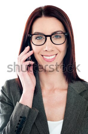 Female manager attending phone call Stock photo © stockyimages