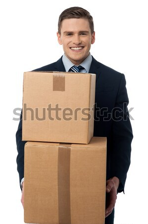 Businessman holding packed carton Stock photo © stockyimages